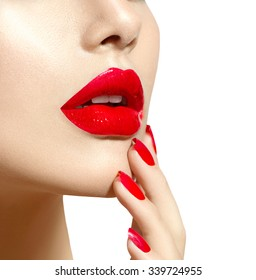 Red Sexy Lips and Nails closeup. Open Mouth. Manicure and Makeup. Make up concept. Beauty model girl's face isolated on white background. Filler injections. Lip augmentation, Beautiful Perfect Lips.
