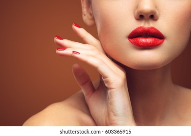 Red Sexy Lips and Nails closeup. Open Mouth. Manicure and Makeup. Make up concept. Kiss.