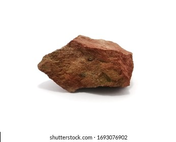 Red shale stone on white background. Shale is a sedimentary rock composed of very fine clay particles.