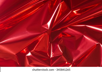 red shiny metallic foil background