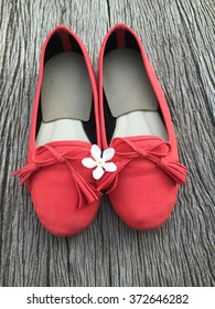 Red shoe and white flower