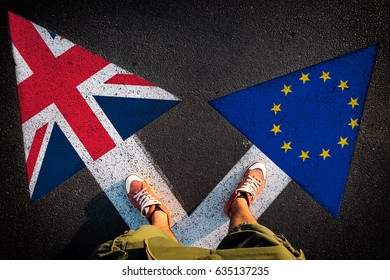 Red shoes from above on the white arrows,dilemmas concept brexit or eu
