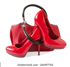 Red shoes and bag isolated on white background