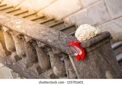 Red shoes and a bouquet on a stairway