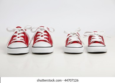Red Shoes isolated on white. Big Brother - Concept.