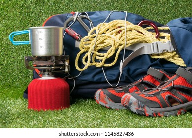 red shoes for mountain tourism, a backpack and household things of the traveler