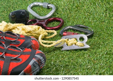 red shoes and ropes for extreme travel outdoors lie on a green background