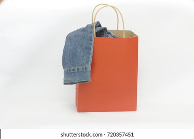 Red shopping bag with cloth in it on isolated white background