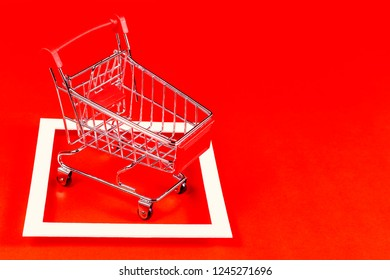 Red shopping cart and canvas on the red background.