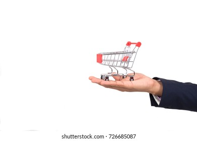 Red shopping cart on hand's businessman on white background isolated, Business concept
