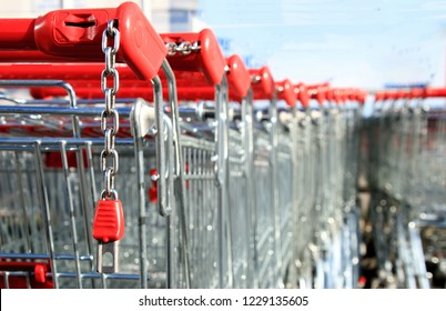 Red shopping carts in a line