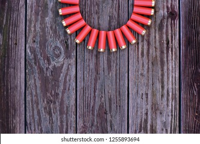 Red Shotgun Shell arrange in half circlle shape on the top on wooden background