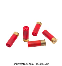 Red shotgun shell that has been fired on a white background.