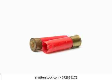 Red shotgun shell used.On white background.