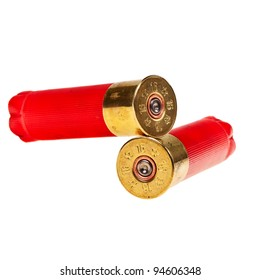 Red shotgun shells isolated over white backgorund.
