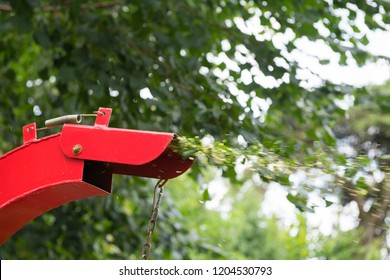 Red shredder working in nature