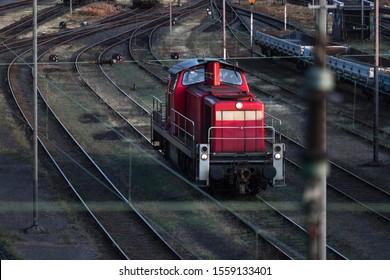 red shunter train on an train cargo station