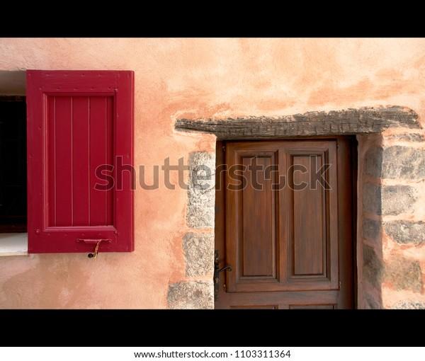 red shutter and wooden door