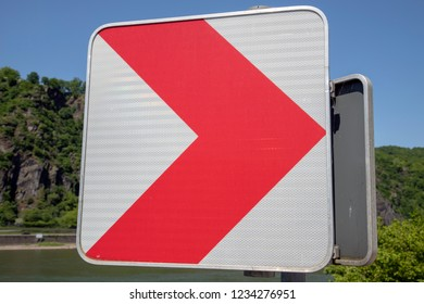 red sign with bue sky