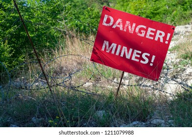 """Red sign """"DANGER! MINES!"""""""