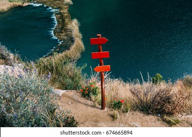 Red sign in the mountains with river in the background
