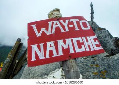 Red sign to Namche Bazaar, Tengboche monastery, Everest Base Camp trek, Nepal
