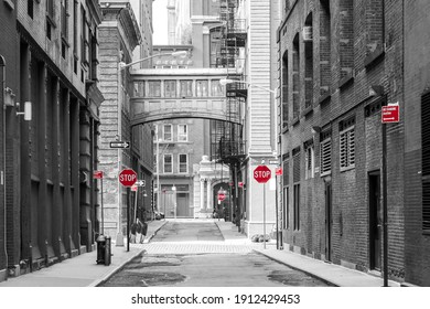 Red signs in a black and white cityscape at the intersection of Jay and Staple Streets in the Tribeca neighborhood of New York City NYC