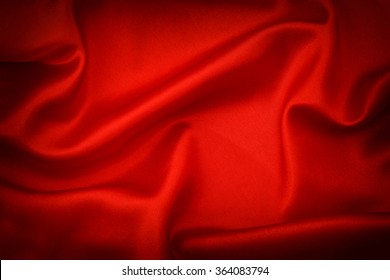 Red silk background. Dark toned with vignette