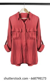 Red silk blouse on wooden clothes rack isolated over white