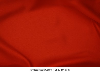 Red silk cloth frame as Christmas background or sale backdrop. Red fabric drapes.  Soft silk cloth or satin texture.
