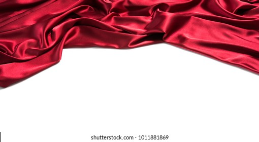 Red silk drapery with copy space for text. Isolated on white background