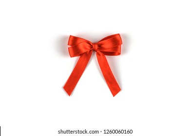 Red silk gift bow isolated on white background. Festive concept.