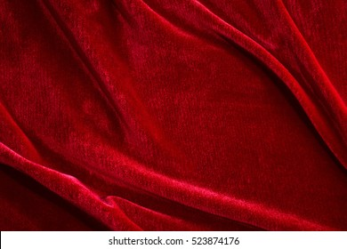 Red silk velvet close-up. Fabric macro for texture and background