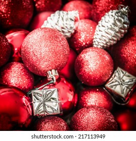 red silver Christmas background with decorations, balloons and gift boxes
