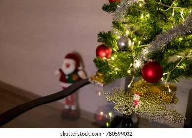 red and silver christmas balls on a Christmas tree, defocused gnome in the background