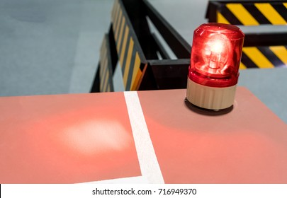 Red siren on metal cabinet. Warning light for safety on work area.