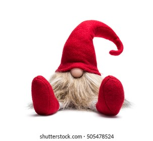 Red sitting christmas elf with pointed cap isolated on white