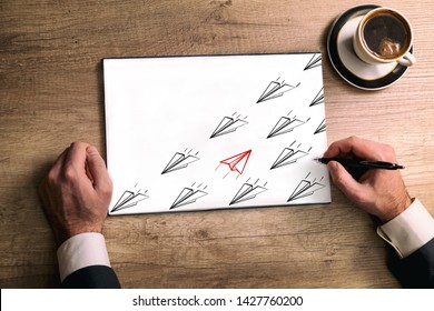 Red  sketch paper airplanes fly in opposite direction from black sketch paper airplanes, Concept of contradiction