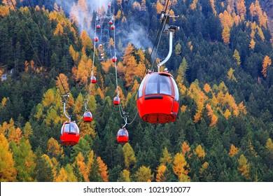 Red ski lift to the Alpe di siusi ski slope from Ortisei ski center in Dolomites, Italy