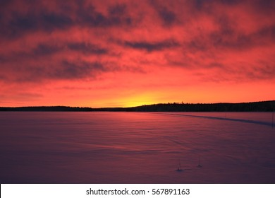 Red sky over Lake Palojarvi in Lapland, Finland