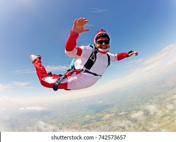 Red Skydiver classic position free fall