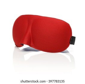 Red sleep mask isolated on white with reflection.