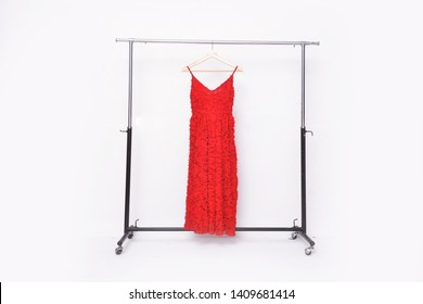 red sleeveless dress with red flower pattern on hanging