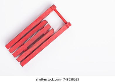 Red sleigh on a white background