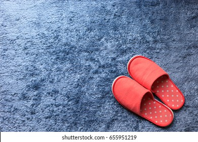 red slipper shoe on blue carpet mat softness texture decorated floor interior house