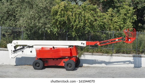 red small mobile cherry picker