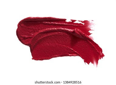 Red smear of matte lip gloss isolated on white background.