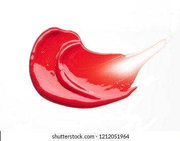 Red smear and texture of lip gloss or acrylic paint isolated on white background
