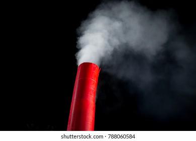 red smoke tower spreading out smoke
