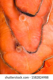 Red smoked fish.Background of pieces of red fish.Red fish cut into pieces.